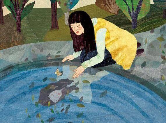 水面を覗き込む女性