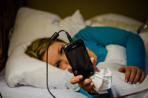 4-cell-phone-in-bed