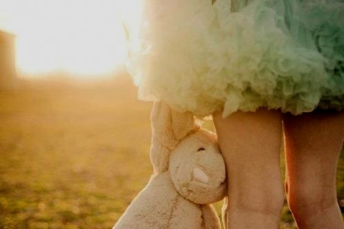 little-girl-holding-stuffed-bear-1