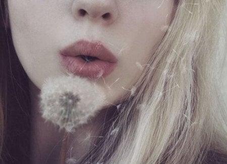 woman-blowing-a-dandelion-450x325