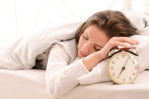 sleeping woman with an alarm clock