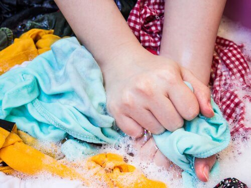 Washing clothes by hand