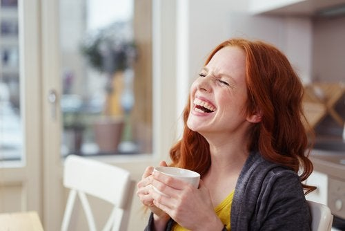 Laughing woman with coffee