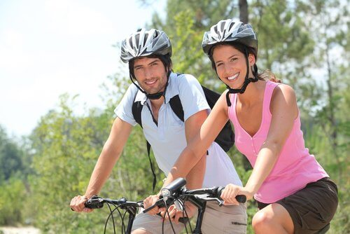 A couple riding bikes