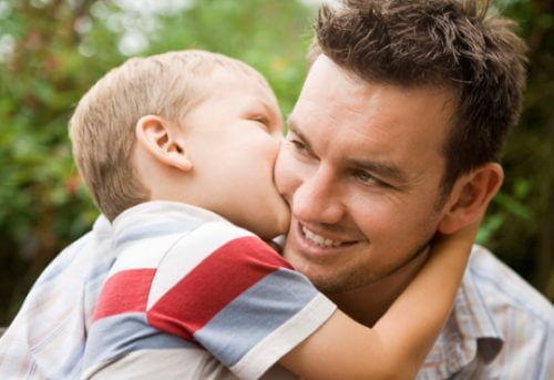 boy kissing dad