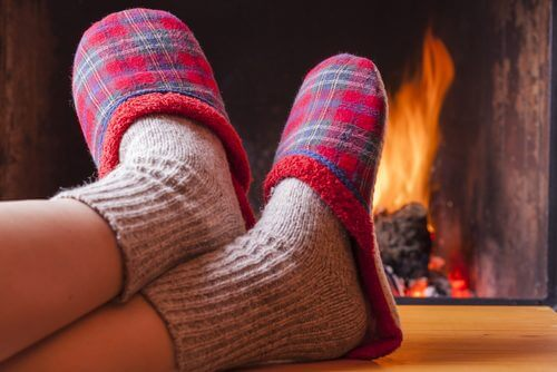 slippers in front of fire