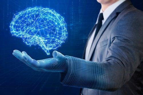 スーツ姿の人の手の上に浮かぶ光の脳