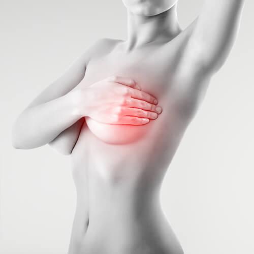 乳房の自己触診をする女性