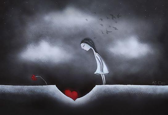 地面の穴を見つめる少女