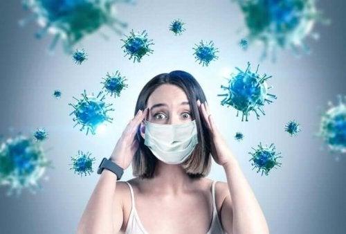 ウイルスとマスクを着ける女性